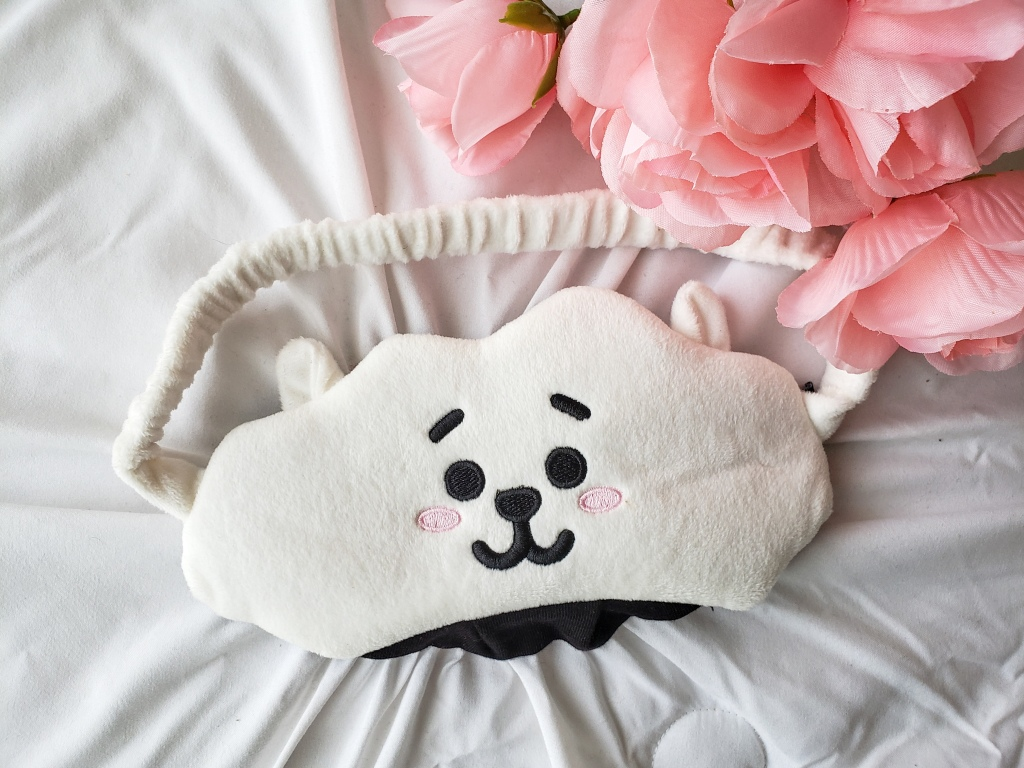 A BT21 RJ sleeping mask with pink roses in the background.