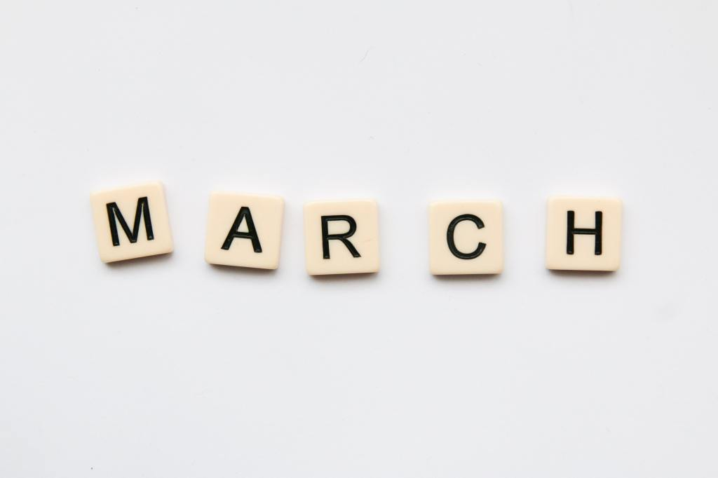 Letter tiles from the game Scrabble are used to spell out the month March